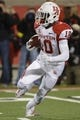 Nov 16, 2013; Louisville, KY, USA; Houston Cougars wide receiver Demarcus Ayers (10) runs with the ball against the Louisville Cardinals during the first quarter at Papa John's Cardinal Stadium. Mandatory Credit: Jamie Rhodes-USA TODAY Sports