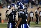 Nov 16, 2013; Durham, NC, USA; Duke Blue Devils quarterback Brandon Connette (18) salutes quarterback Anthony Boone (7) after Connette scored a touchdown against the Miami Hurricanes at Wallace Wade Stadium. Mandatory Credit: Mark Dolejs-USA TODAY Sports