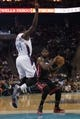 Nov 16, 2013; Charlotte, NC, USA; Miami Heat small forward LeBron James (6) is defended by Charlotte Bobcats small forward Michael Kidd-Gilchrist (14) during the first half at Time Warner Cable Arena. Mandatory Credit: Jeremy Brevard-USA TODAY Sports