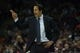 Nov 16, 2013; Charlotte, NC, USA;  Miami Heat head coach Erik Spoelstra yells out during the first half of the game against the Charlotte Bobcats at Time Warner Cable Arena. Mandatory Credit: Jeremy Brevard-USA TODAY Sports