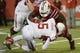 Nov 16, 2013; Louisville, KY, USA; Louisville Cardinals defensive tackle Brandon Dunn (92) sacks Houston Cougars quarterback John O'Korn (5) during the second quarter at Papa John's Cardinal Stadium. Mandatory Credit: Jamie Rhodes-USA TODAY Sports