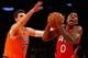 Nov 16, 2013; New York, NY, USA;  Atlanta Hawks point guard Jeff Teague (0) drives to the net as New York Knicks power forward Andrea Bargnani (77) defends during the first quarterat Madison Square Garden. Mandatory Credit: Anthony Gruppuso-USA TODAY Sports