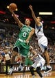 Nov 16, 2013; Minneapolis, MN, USA; Boston Celtics point guard Avery Bradley (0) goes up for a layup past Minnesota Timberwolves shooting guard Kevin Martin (23) in the first half at Target Center. Mandatory Credit: Jesse Johnson-USA TODAY Sports