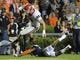 Nov 16, 2013; Auburn, AL, USA; Georgia Bulldogs defensive end Toby Johnson (88) leaps over Auburn Tigers defensive back Ryan White (19) on a touchdown run during the second half at Jordan Hare Stadium. The Tigers defeated the Bulldogs 43-38. Mandatory Credit: Shanna Lockwood-USA TODAY Sports