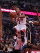 Nov 16, 2013; Chicago, IL, USA; Chicago Bulls point guard Derrick Rose (1) drives past Indiana Pacers power forward David West (21) during the second quarter at  the United Center. Mandatory Credit: Dennis Wierzbicki-USA TODAY Sports