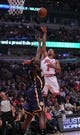 Nov 16, 2013; Chicago, IL, USA; Chicago Bulls point guard Derrick Rose (1) scores over Indiana Pacers center Ian Mahinmi (28) during the second quarter at  the United Center. Mandatory Credit: Dennis Wierzbicki-USA TODAY Sports