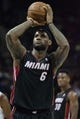 Nov 16, 2013; Charlotte, NC, USA; Miami Heat small forward LeBron James (6) shoots a free throw during the first half against the Charlotte Bobcats at Time Warner Cable Arena. Miami defeated Charlotte 97-81. Mandatory Credit: Jeremy Brevard-USA TODAY Sports