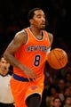 Nov 16, 2013; New York, NY, USA;  New York Knicks shooting guard J.R. Smith (8) advances the ball during the third quarter against the Atlanta Hawks at Madison Square Garden. Atlanta Hawks won 110-90.  Mandatory Credit: Anthony Gruppuso-USA TODAY Sports