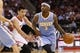 Nov 16, 2013; Houston, TX, USA; Denver Nuggets guard Ty Lawson (3) dribbles the ball against Houston Rockets guard Jeremy Lin (left) during the second half at Toyota Center. The Rockets won 122-111. Mandatory Credit: Soobum Im-USA TODAY Sports