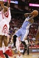 Nov 16, 2013; Houston, TX, USA; Denver Nuggets guard Ty Lawson (3) passes the ball around Houston Rockets forward Terrence Jones (left) during the second half at Toyota Center. The Rockets won 122-111. Mandatory Credit: Soobum Im-USA TODAY Sports