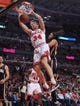 Nov 16, 2013; Chicago, IL, USA; Chicago Bulls small forward Mike Dunleavy (34) dunks past Indiana Pacers small forward Chris Copeland (22) during the second half at  the United Center. Chicago won 110-94. Mandatory Credit: Dennis Wierzbicki-USA TODAY Sports