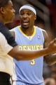 Nov 16, 2013; Houston, TX, USA; Denver Nuggets guard Ty Lawson (3) argues with NBA referee Leroy Richardson during the second half against the Houston Rockets at Toyota Center. The Rockets won 122-111. Mandatory Credit: Soobum Im-USA TODAY Sports