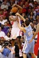 Nov 16, 2013; Houston, TX, USA; Houston Rockets guard James Harden (13) gets fouled while shooting against Denver Nuggets guard Evan Fournier (94) during the second half at Toyota Center. The Rockets won 122-111. Mandatory Credit: Soobum Im-USA TODAY Sports