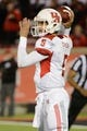 Nov 16, 2013; Louisville, KY, USA; Houston Cougars quarterback John O'Korn (5) looks to pass the ball against the Louisville Cardinals during the second half of play at Papa John's Cardinal Stadium. Louisville defeated Houston 20-13.  Mandatory Credit: Jamie Rhodes-USA TODAY Sports