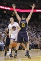 Nov 16, 2013; Oakland, CA, USA; Golden State Warriors guard Klay Thompson (11) passes the ball around the reach of Utah Jazz center Enes Kanter (0) in the second quarter at Oracle Arena. Mandatory Credit: Cary Edmondson-USA TODAY Sports