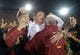Nov 16, 2013; Los Angeles, CA, USA; Southern California Trojans coach Ed Orgeron celebrates with fans at the end of the game against the Stanford Cardinal at Los Angeles Memorial Coliseum. USC defeated Stanford 20-17. Mandatory Credit: Kirby Lee-USA TODAY Sports