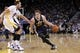 Nov 16, 2013; Oakland, CA, USA; Utah Jazz guard Gordon Hayward (20) drives past Golden State Warriors center Andrew Bogut (12) in the third quarter at Oracle Arena. The Warriors defeated the Jazz 102-88. Mandatory Credit: Cary Edmondson-USA TODAY Sports