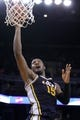 Nov 16, 2013; Oakland, CA, USA; Utah Jazz forward Derrick Favors (15) attempts a shot against the Golden State Warriors in the third quarter at Oracle Arena. The Warriors defeated the Jazz 102-88. Mandatory Credit: Cary Edmondson-USA TODAY Sports