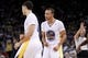 Nov 16, 2013; Oakland, CA, USA; Golden State Warriors guard Stephen Curry (30) reacts after guard Klay Thompson (11) made a three point shot against the Utah Jazz in the fourth quarter at Oracle Arena. The Warriors defeated the Jazz 102-88. Mandatory Credit: Cary Edmondson-USA TODAY Sports