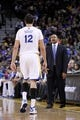 Nov 16, 2013; Oakland, CA, USA; Golden State Warriors head coach Mark Jackson talks with center Andrew Bogut (12) during a break in the action against the Utah Jazz in the fourth quarter at Oracle Arena. The Warriors defeated the Jazz 102-88. Mandatory Credit: Cary Edmondson-USA TODAY Sports