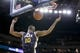 Nov 16, 2013; Oakland, CA, USA; Utah Jazz guard Alec Burks (10) follows through on a dunk against the Golden State Warriors in the fourth quarter at Oracle Arena. The Warriors defeated the Jazz 102-88. Mandatory Credit: Cary Edmondson-USA TODAY Sports
