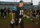 Nov 17, 2013; Jacksonville, FL, USA; Jacksonville Jaguars quarterback Blaine Gabbert (11) walks off the field after their game against the Arizona Cardinals at EverBank Field. The Arizona Cardinals beat the Jacksonville Jaguars 27-14. Mandatory Credit: Phil Sears-USA TODAY Sports