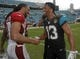 Nov 17, 2013; Jacksonville, FL, USA; Arizona Cardinals wide receiver Larry Fitzgerald (11) shakes hands with Jacksonville Jaguars wide receiver Kerry Taylor (13) after their game at EverBank Field. Taylor was recently traded to the Jaguars from the Cardinals. The Arizona Cardinals beat the Jacksonville Jaguars 27-14. Mandatory Credit: Phil Sears-USA TODAY Sports