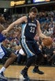 Nov 17, 2013; Sacramento, CA, USA; Memphis Grizzlies center Marc Gasol (33) takes the ball to the basket against Sacramento Kings power forward Jason Thompson (34) during the first quarter at Sleep Train Arena. Mandatory Credit: Ed Szczepanski-USA TODAY Sports