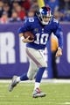 Nov 17, 2013; East Rutherford, NJ, USA; New York Giants quarterback Eli Manning (10) runs with the ball against the Green Bay Packers during the fourth quarter of a game at MetLife Stadium. Mandatory Credit: Brad Penner-USA TODAY Sports