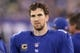 Nov 17, 2013; East Rutherford, NJ, USA; New York Giants quarterback Eli Manning (10) on the sidelines against the Green Bay Packers during the fourth quarter of a game at MetLife Stadium. Mandatory Credit: Brad Penner-USA TODAY Sports