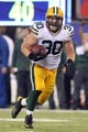Nov 17, 2013; East Rutherford, NJ, USA; Green Bay Packers fullback John Kuhn (30) runs the ball against the New York Giants during the fourth quarter of a game at MetLife Stadium. Mandatory Credit: Brad Penner-USA TODAY Sports
