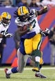 Nov 17, 2013; East Rutherford, NJ, USA; Green Bay Packers running back Eddie Lacy (27) runs the ball against the New York Giants during the third quarter of a game at MetLife Stadium. Mandatory Credit: Brad Penner-USA TODAY Sports