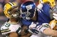 Nov 17, 2013; East Rutherford, NJ, USA; New York Giants running back Andre Brown (35) has his helmet twisted as he is tackled by Green Bay Packers linebacker Brad Jones (59) during the second quarter of a game at MetLife Stadium. Mandatory Credit: Brad Penner-USA TODAY Sports