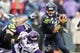 Nov 17, 2013; Seattle, WA, USA; Seattle Seahawks quarterback Russell Wilson (3) scrambles away from pressure by the Minnesota Vikings during the fourth quarter at CenturyLink Field. Mandatory Credit: Joe Nicholson-USA TODAY Sports