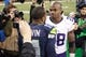 Nov 17, 2013; Seattle, WA, USA; Minnesota Vikings running back Adrian Peterson (28) talks with Seattle Seahawks wide receiver Percy Harvin (11) following a 41-20 Seattle victory at CenturyLink Field. Mandatory Credit: Joe Nicholson-USA TODAY Sports