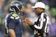Nov 17, 2013; Seattle, WA, USA; Seattle Seahawks quarterback Russell Wilson (3) talks with referee Jerom Boger (23) during a third quarter timeout against the Minnesota Vikings at CenturyLink Field. Mandatory Credit: Joe Nicholson-USA TODAY Sports