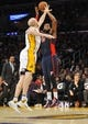 November 17, 2013; Los Angeles, CA, USA; Detroit Pistons power forward Greg Monroe (10) shoots a basket against the defense of Los Angeles Lakers point guard Steve Blake (5) during the first half at Staples Center. Mandatory Credit: Gary A. Vasquez-USA TODAY Sports
