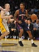 November 17, 2013; Los Angeles, CA, USA; Detroit Pistons point guard Brandon Jennings (7) moves the ball against the defense of Los Angeles Lakers  point guard Steve Blake (5) during the first half at Staples Center. Mandatory Credit: Gary A. Vasquez-USA TODAY Sports