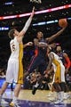 November 17, 2013; Los Angeles, CA, USA; Detroit Pistons point guard Brandon Jennings (7) goes in for a basket against the defense of Los Angeles Lakers center Pau Gasol (16) during the first half at Staples Center. Mandatory Credit: Gary A. Vasquez-USA TODAY Sports