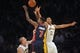 November 17, 2013; Los Angeles, CA, USA; Los Angeles Lakers shooting guard Wesley Johnson (11) blocks a shot attempt by Detroit Pistons point guard Brandon Jennings (7) during the second half at Staples Center. Mandatory Credit: Gary A. Vasquez-USA TODAY Sports