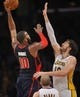 November 17, 2013; Los Angeles, CA, USA; Detroit Pistons power forward Greg Monroe (10) moves to the basket against the defense of Los Angeles Lakers center Pau Gasol (16) during the second half at Staples Center. Mandatory Credit: Gary A. Vasquez-USA TODAY Sports