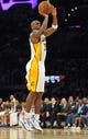 November 17, 2013; Los Angeles, CA, USA; Los Angeles Lakers shooting guard Jodie Meeks (20) shoots a three point basket against the Detroit Pistons during the second half at Staples Center. Mandatory Credit: Gary A. Vasquez-USA TODAY Sports