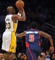 November 17, 2013; Los Angeles, CA, USA; Los Angeles Lakers shooting guard Jodie Meeks (20) shoots a basket against the defense of Detroit Pistons shooting guard Kentavious Caldwell-Pope (5) during the first half at Staples Center. Mandatory Credit: Gary A. Vasquez-USA TODAY Sports
