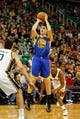 Nov 18, 2013; Salt Lake City, UT, USA; Golden State Warriors shooting guard Klay Thompson (11) shoots a jump shot during the first quarter of the game against the Utah Jazz at EnergySolutions Arena. Mandatory Credit: Chris Nicoll-USA TODAY Sports
