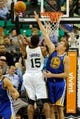 Nov 18, 2013; Salt Lake City, UT, USA; Utah Jazz power forward Derrick Favors (15) shoots over Golden State Warriors power forward David Lee (10) during the first quarter at EnergySolutions Arena. Mandatory Credit: Chris Nicoll-USA TODAY Sports