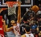 Nov 18, 2013; Chicago, IL, USA; Chicago Bulls center Joakim Noah (13) blocks Charlotte Bobcats small forward Michael Kidd-Gilchrist (14) during the second half of their game at the United Center. The Bulls won 86-81. Mandatory Credit: Matt Marton-USA TODAY Sports