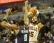 Nov 18, 2013; Chicago, IL, USA; Chicago Bulls power forward Carlos Boozer (5) shoots the ball oaver Charlotte Bobcats center Bismack Biyombo (0) during the second half at the United Center. The Bulls won 86-81. Mandatory Credit: Matt Marton-USA TODAY Sports