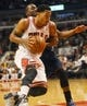Nov 18, 2013; Chicago, IL, USA; Chicago Bulls point guard Derrick Rose (1) drives against the Charlotte Bobcats during the second half of their game at the United Center. The Bulls won 86-81. Mandatory Credit: Matt Marton-USA TODAY Sports