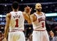 Nov 18, 2013; Chicago, IL, USA; Chicago Bulls point guard Derrick Rose (1) and Chicago Bulls power forward Carlos Boozer (5) high-five against the Charlotte Bobcats during the second half of their game at the United Center. The Bulls won 86-81. Mandatory Credit: Matt Marton-USA TODAY Sports