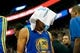 Nov 18, 2013; Salt Lake City, UT, USA; Golden State Warriors point guard Stephen Curry (30) walks in to the locker room with a towel over his head after Utah Jazz power forward Marvin Williams (2) landed on his head during the fourth quarter at EnergySolutions Arena. Mandatory Credit: Chris Nicoll-USA TODAY Sports